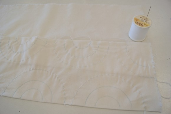 First sew the outer circles through both layers of fabric with running stitch