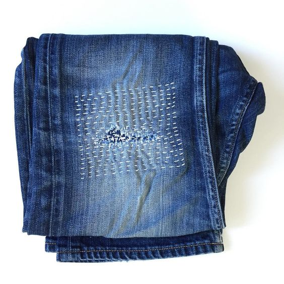 Visible mending with Sashiko stitching on jeans
