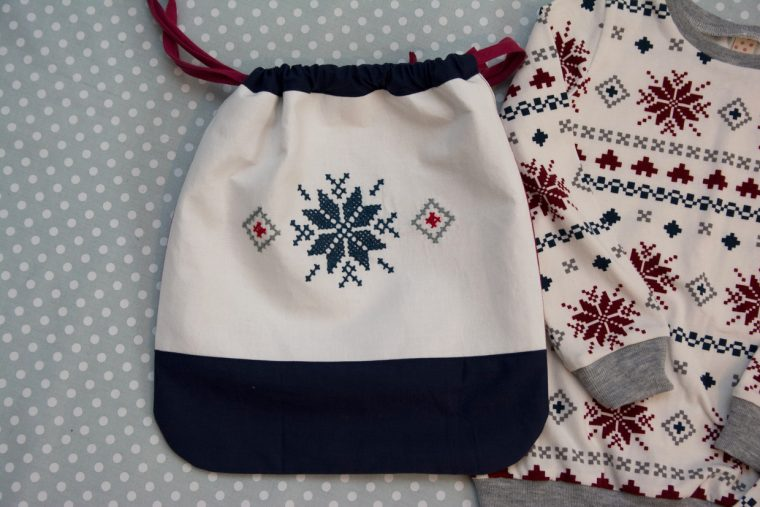 Oliver + S Little Things to Sew drawstring bag used as a Christmas pajama storage bag