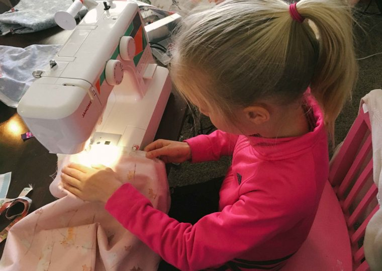 Girl sewing an Oliver + S Lazy Days Skirt
