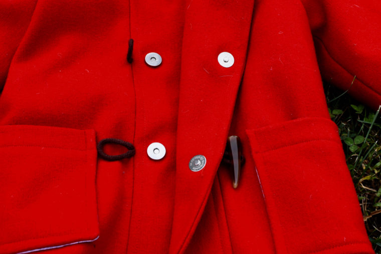 Red wool coat with magnetic snaps.