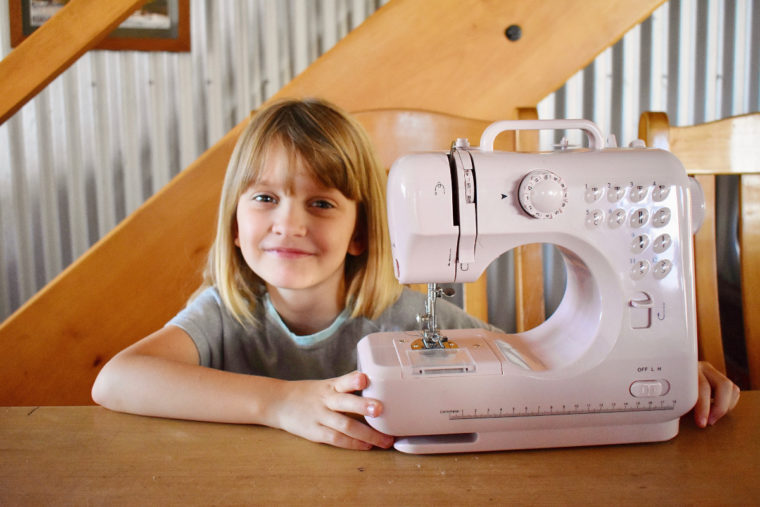 Teaching kids to sew.