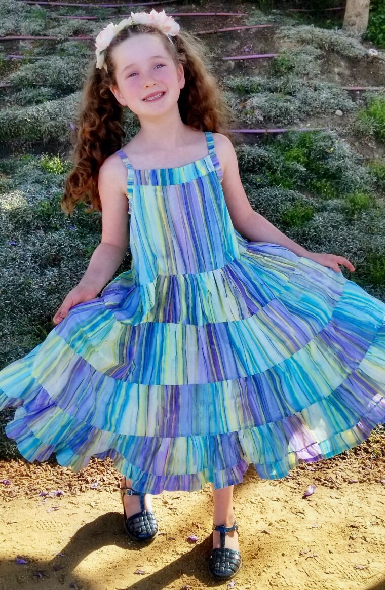 Learn to sew this adorable child's dress in sizes 2-8 with our free pattern and tutorial.